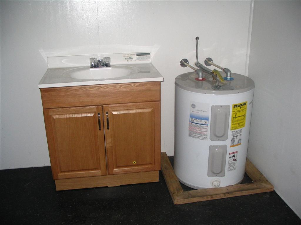 Restroom with sink and water heater